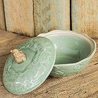 Celadon ceramic lidded bowl, 'Sawasdee' - Handcrafted Green Ceramic Bowl and Lid with Elephant Motif