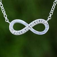 Sterling silver pendant necklace, 'Infinite Glamour' - Infinity Symbol Necklace in Sterling with Cubic Zirconia