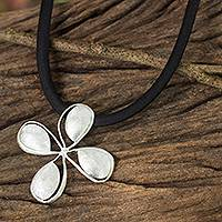 Sterling silver pendant necklace, 'Wind Blossom' - Brushed Satin Silver Flower Necklace on Black Silk Cord