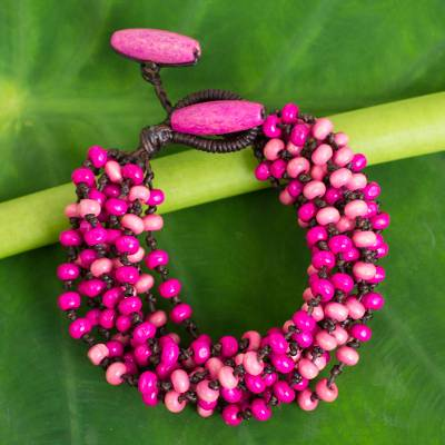 Wood torsade bracelet, 'Pink Orchid Duality' - Hand Knotted Torsade Bracelet Wood Beaded Jewelry