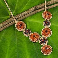 Carnelian and garnet flower necklace, 'Floral Garland in Orange' - Beaded Carnelian and Garnet Floral Pendant Necklace