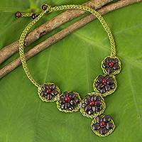 Garnet beaded flower necklace, 'Crimson Daisy' - Artisan Crafted Garnet Flower Necklace on Green Cords