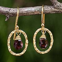 Gold plated garnet dangle earrings, 'Crimson Portal' - Fair Trade Garnet Earrings with 24k Gold Plated Brass