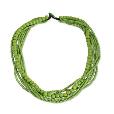 Wood beaded necklace, 'Oasis Dance' - Long Multi Strand Bright Green Beaded Wood Necklace