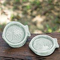Celadon ceramic coasters, 'Blue Fish' (pair) - Handcrafted Light Blue Thai Celadon Ceramic Coasters (Pair)