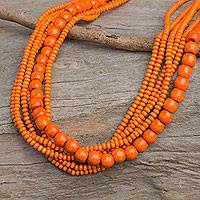 Wood beaded necklace, 'Solar Dance' - Orange Wood Bead Necklace Hand Crafted in Thailand