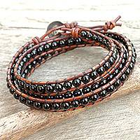 Onyx wrap bracelet, 'Surin Night' - Onyx and Leather Wrap Bracelet with Hill Tribe Silver Clasp