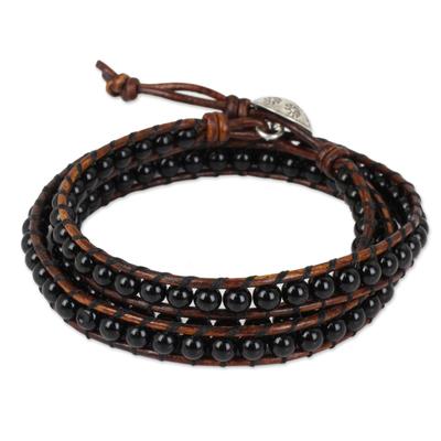 Onyx wrap bracelet, 'Surin Night' - Onyx and Leather Wrap Bracelet with Hill Tribe Silver Clasp