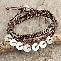 Leather and silver wrap bracelet, 'Bronze Round Factor' - Hill Tribe Silver Charms on Artisan Crafted Leather Bracelet