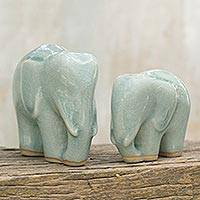 Celadon ceramic figurines, 'Elephant Bond in Light Blue' (pair) - Light Blue Celadon Ceramic Figurines of Elephants (Pair)