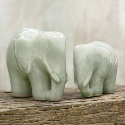 Celadon ceramic figurines, 'Elephant Bond in Light Green' (pair) - Light Green Celadon Ceramic Figurines of Elephants (Pair)