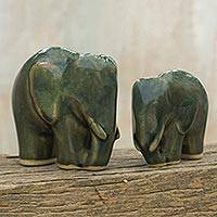 Celadon ceramic figurines, 'Elephant Bond in Dark Green' (pair) - Celadon Ceramic Dark Green Elephant Figurines (Pair)