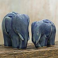 Celadon ceramic figurines, 'Elephant Bond in Dark Blue' (pair) - Handmade Blue Celadon Ceramic Elephant Figurines (Pair)