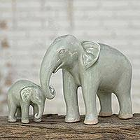 Celadon ceramic figurines, 'Papa and Me' (pair) - Handmade Green Celadon Ceramic Elephant Figurines (Pair)