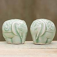 Celadon ceramic figurines, 'Elephant Couple' (pair) - Pair of Handmade Thai Celadon Ceramic Elephant Figurines