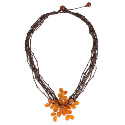 Carnelian beaded pendant necklace, 'Twigs and Flowers' - Carnelian Flower Pendant Necklace on Brown Cords