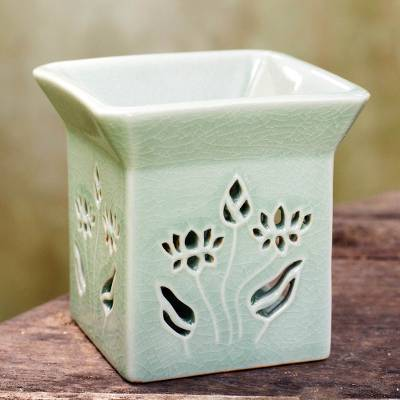 Ceramic clay oil warmer, 'Lotus Garden' - Floral Ceramic Clay Tealight Oil Warmer Handcrafted Thailand