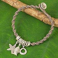 Silver charm bracelet,