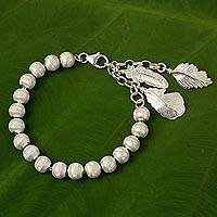 Sterling silver beaded charm bracelet, 'Feather Grace' - Artisan Crafted Sterling Silver Beaded Charm Bracelet