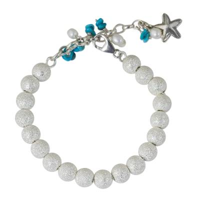 Artisan Crafted Silver Bracelet with Starfish Charm