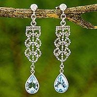 Blue topaz dangle earrings, 'Whispering Sky' - Artisan Crafted Silver and Blue Topaz Dangle Earrings