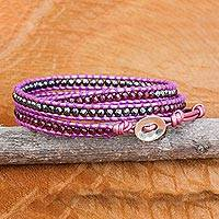 Hematite and garnet wrap bracelet, 'Lavender Wine' - Dyed Leather Garnet Hematite Sterling Silver Wrap Bracelet