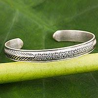 Sterling silver cuff bracelet, 'Hill Tribe Song of Love' - Karen Hill Tribe Handcrafted Silver Love Theme Bracelet