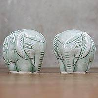 Celadon figurines, 'Elephant Paramours' (pair) - Pair of Handmade Thai Celadon Ceramic Elephant Figurines