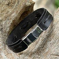 Leather wristband bracelet, 'Roadside Stroll in Black' - Hand Crafted Black Leather Wristband Bracelet from Thailand