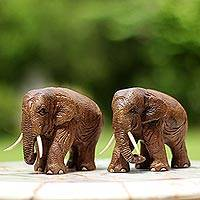 Teakwood sculptures, 'Walk Together' (pair) - Brown Teakwood Elephant Sculptures (Pair) from Thailand