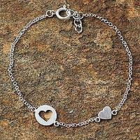 Sterling silver station bracelet, 'Puzzling Hearts' - Sterling Silver Heart Shaped Station Bracelet from Thailand