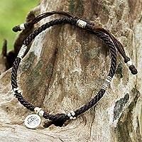 Silver braided bracelet, 'Hill Tribe Ohm' - Hill Tribe Style Brown Braided Bracelet with 950 Silver Ohm