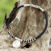 Silver braided bracelet, 'Pretty Moon' - Handmade Black Braided Bracelet with Karen Silver Medallion