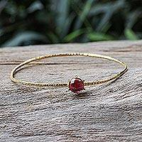 Gold plated garnet bangle bracelet, 'Meteor' - Gold Plated Garnet Bangle Bracelet from Thailand