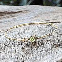 Gold plated peridot bangle bracelet, 'Charming Luck' - Gold Plated Bangle with Peridot Pendant from Thailand
