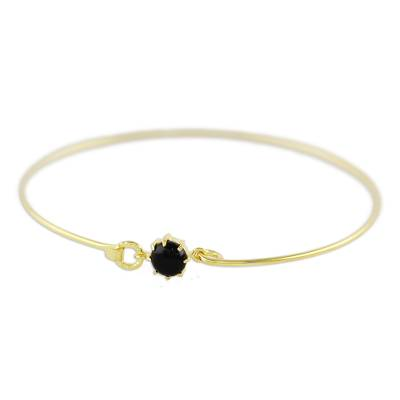 Gold plated onyx bangle bracelet, 'Charming Luck in Black' - Gold Plated Black Onyx Bangle Bracelet from Thailand