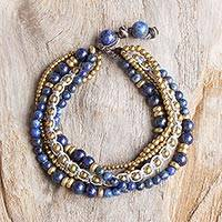 Lapis lazuli beaded bracelet, 'Brisk Ocean' - Brass and Lapis Lazuli Multi-Strand Beaded Bracelet