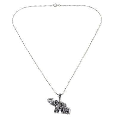 Garnet and marcasite pendant necklace, 'Glittering Elephants' - Garnet and Marcasite Elephant Pendant Necklace from Thailand