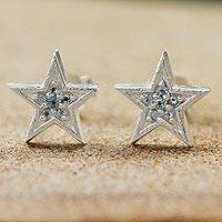 Blue topaz stud earrings, 'Sparkling Star' - Thailand Sterling Silver and Blue Topaz Petite Star Earrings