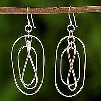 Sterling silver dangle earrings, 'Elegant Dance' - Sterling Silver Twisting Dangle Earrings from Thailand