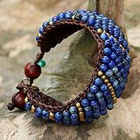 Lapis lazuli beaded wristband bracelet, 'Thai Smile' - Lapis Lazuli and Brass Beaded Bracelet from Thailand