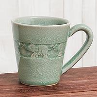 Celadon ceramic mug, 'Elephant Babies' - Hand Crafted Celadon Ceramic Elephant Mug from Thailand