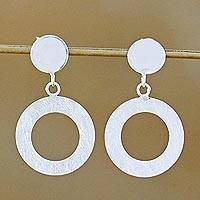 Sterling silver dangle earrings, 'Circular Portals' - Sterling Silver Brushed Satin Circle Thai Dangle Earrings