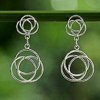 Sterling silver dangle earrings, 'Stellar Circles' - Sterling Silver Circular Dangle Earrings from Thailand