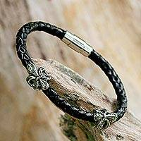 Leather wristband bracelet, 'Fleur of Strength' - Black Leather Wristband Bracelet with Fleur de Lis