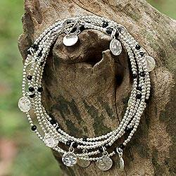 Onyx wrap bracelet, 'Rain Charms in Black' - 925 Sterling Silver Plated Black Onyx Bracelet from Thailand