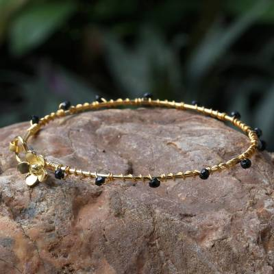 Gold plated onyx bangle bracelet, 'Floral Berries' - Gold Plated Onyx Floral Bangle Bracelet from Thailand