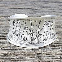 Sterling silver cuff bracelet, 'Lanna Elephants' - Elephant-Themed Sterling Silver Cuff Bracelet from Thailand