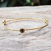 Gold plated garnet bangle bracelet, 'Orbit of Beauty' - Handcrafted Garnet Bangle Bracelet Bathed in 18k Gold