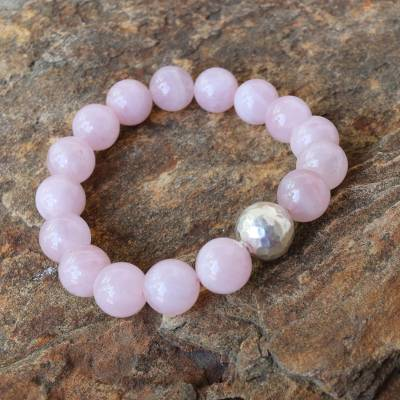 Rose quartz beaded stretch bracelet, 'Spatial Love' - Beaded Karen Silver and Rose Quartz Bracelet from Thailand